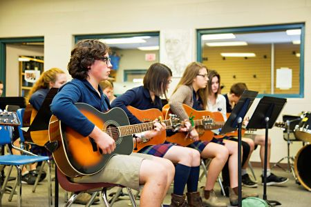 Students Playing Guitars in Music Class
